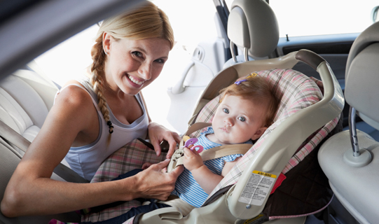 Mother with baby in car seat