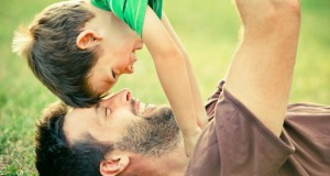 dad play with son outdoor at park