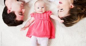 Baby: Baby Lying Between Parents