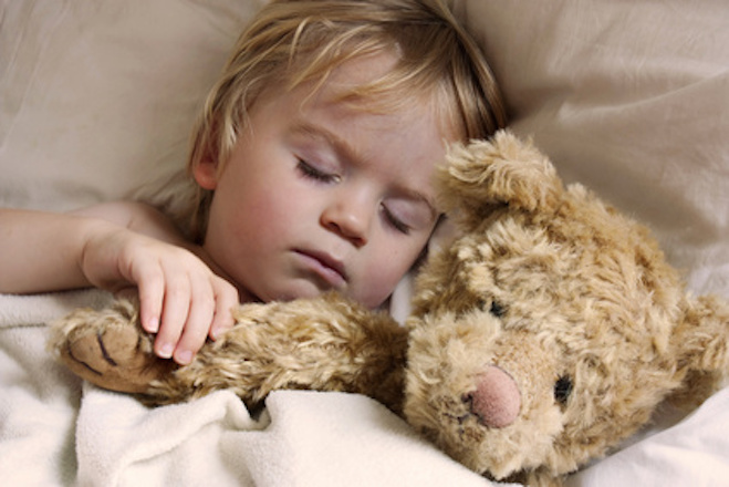 cute young baby toddler asleep with teddy bear
