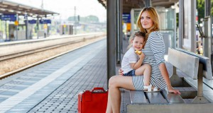 mother-and-child-on-train-station-platform