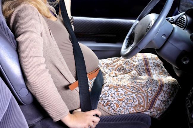 Pregnant woman in car